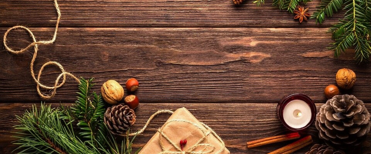 an aerial shot of christmas decorations on a wooden table2
