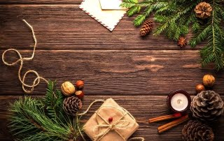 an aerial shot of christmas decorations on a wooden table