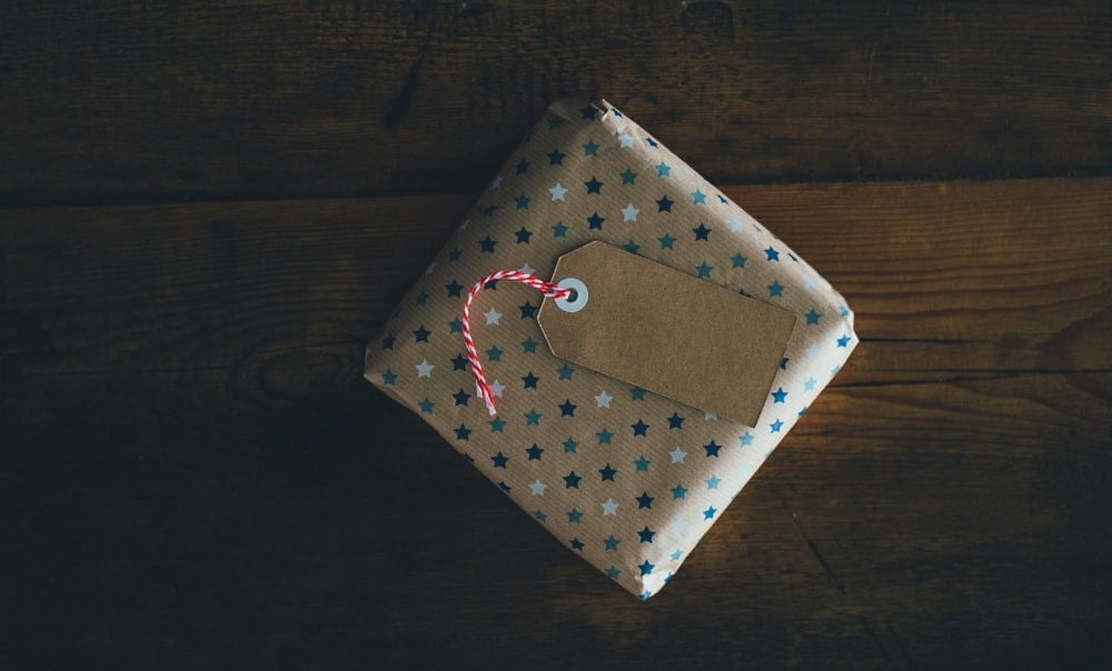 a gift in golden wrapping paper with blue stars