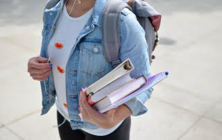 university student holding books